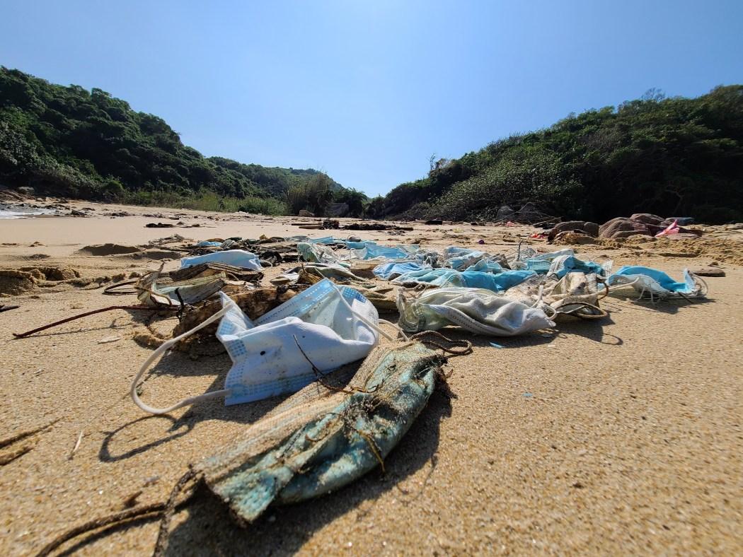 Facemasks lying on a beach