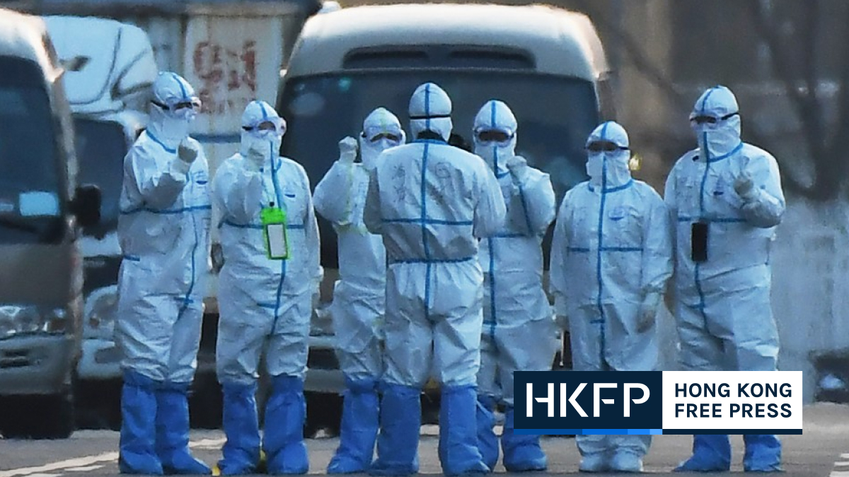 China COVID workers in PPE