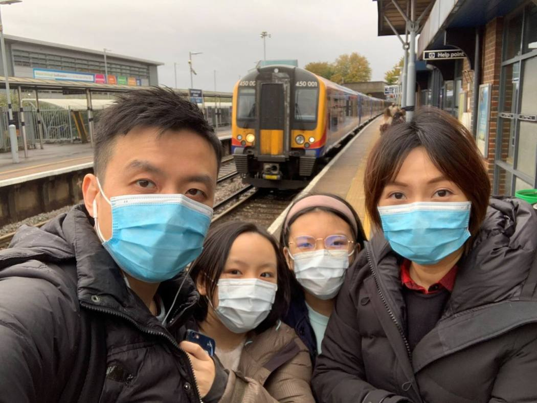 Gavin Mok, his wife and children, wait for a train in the UK after moving to Britain in October Photo: Gavin Mok