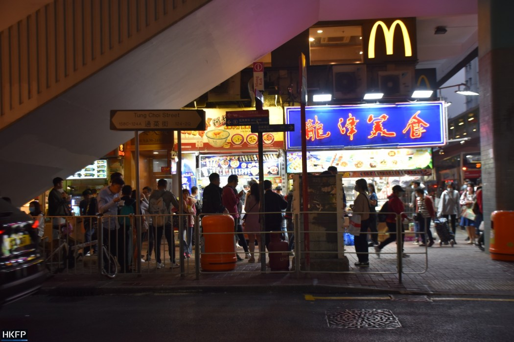 People eating on the street in Mong Kok