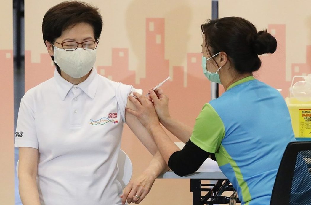 hong kong government officials receive first covid-19 vaccine 1 carrie lam sinovac