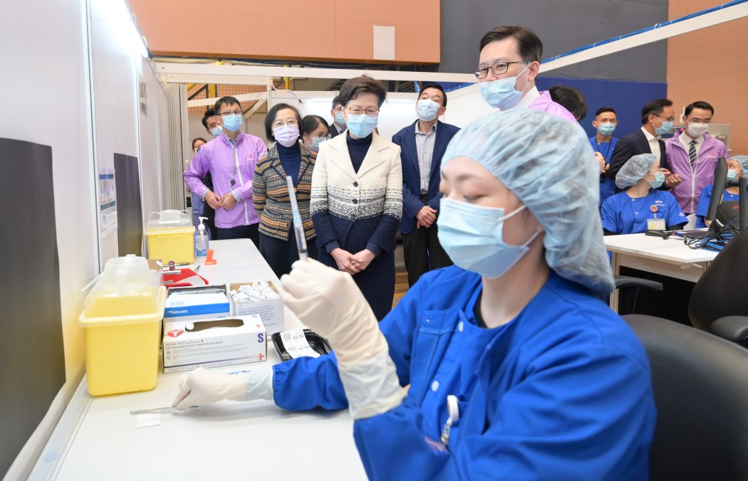 Carrie Lam observes vaccine administration at a vaccination community centre
