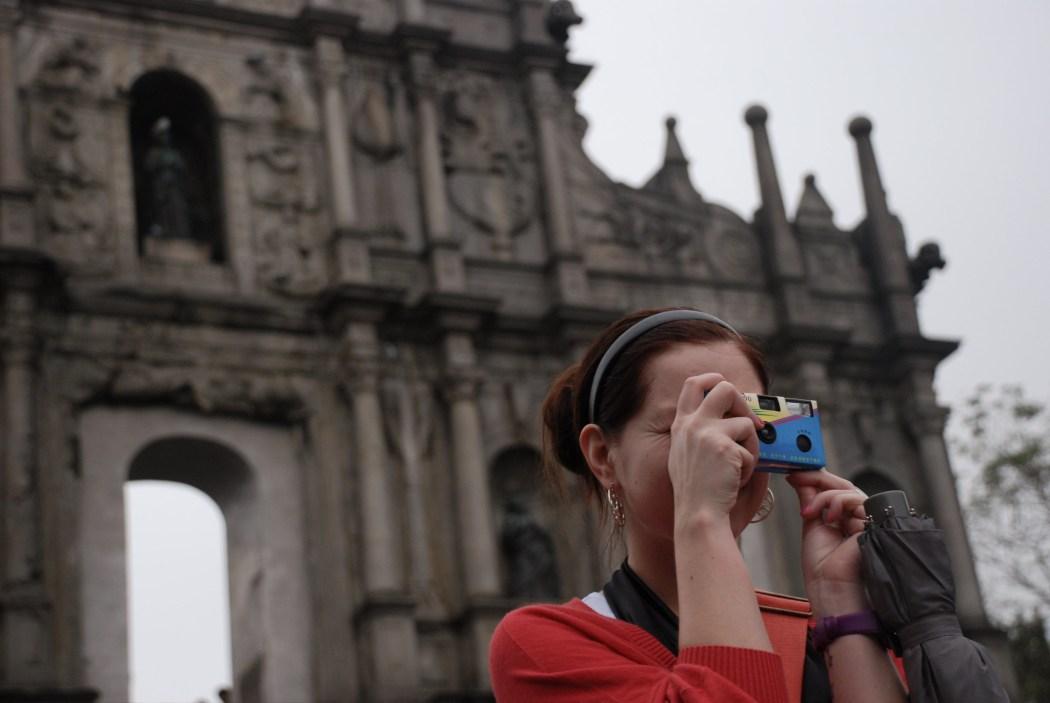 Macau tourism. Tourist taking a photo.