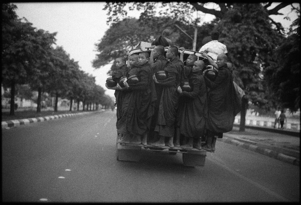 Gary_Knight - Buddhist monks driving to collect alms at dawn, Mandalay, 2012.