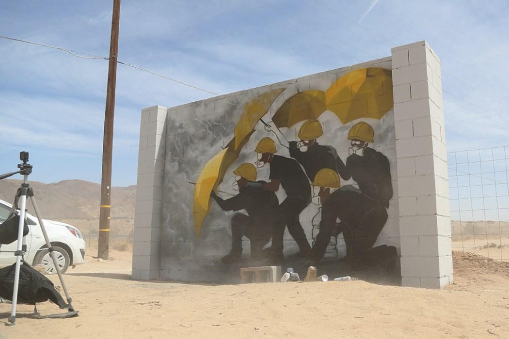 yellow umbrella Lion Rock Cafe Mural at Liberty Sculpture Park, California. Photo: Thirdblade Photography.