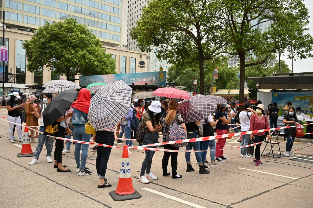 Migrant workers queue