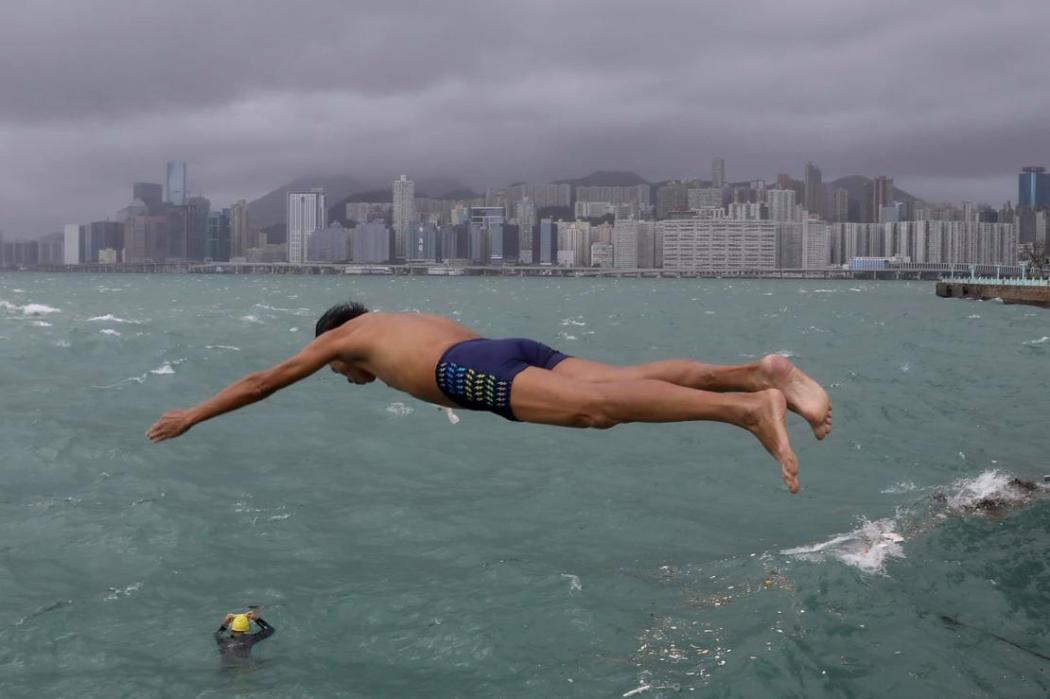 A swimmer in Whampoa during Typhoon Kompasu.